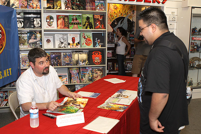 Jonathan gives advice to a fan at Collector's Paradise.