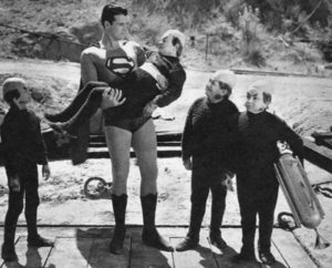 Superman helps the injured Mole Man